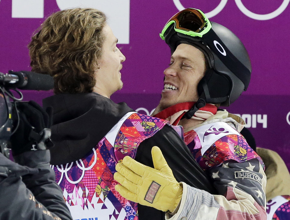 Photo - Switzerland's Iouri Podladtchikov, left, celebrates with Shaun White of the United States after  Podladtchikov won the gold medal in the men's snowboard halfpipe final at the Rosa Khutor Extreme Park, at the 2014 Winter Olympics, Tuesday, Feb. 11, 2014, in Krasnaya Polyana, Russia. (AP Photo/Andy Wong)