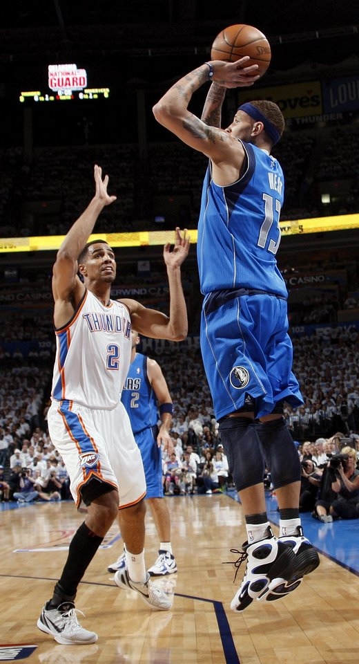 Photo - Dallas' Delonte West (13) shoots over Oklahoma City's Thabo Sefolosha (2) during Game 2 of the first round in the NBA basketball  playoffs between the Oklahoma City Thunder and the Dallas Mavericks at Chesapeake Energy Arena in Oklahoma City, Monday, April 30, 2012. Photo by Nate Billings, The Oklahoman