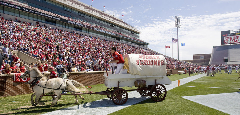 OU's the Sooner Schooner leaves the field after a score during Oklahoma's Red-White football game at The Gaylord Family - Oklahoma Memorial Stadiumin Norman, Okla., Saturday, April 11, 2009. Photo by Bryan Terry, The Oklahoman
