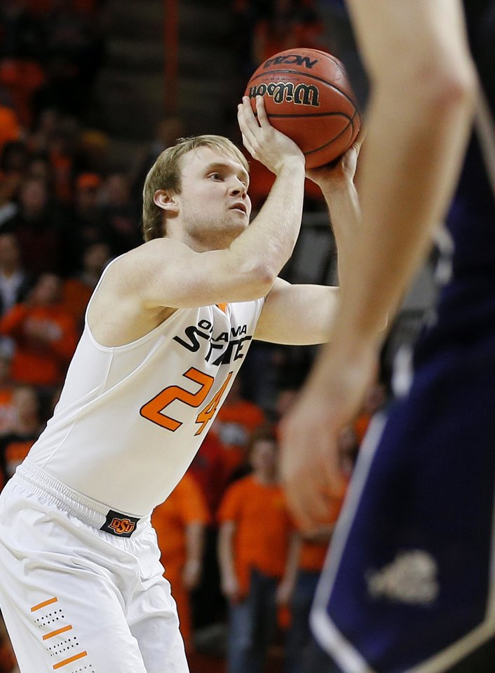 Photo - Oklahoma State's Alex Budke (24) shoots a three-point basket during an NCAA college basketball game between Oklahoma State University (OSU) and TCU at Gallagher-Iba Arena in Stillwater, Okla., Wednesday, Jan. 15, 2014. Oklahoma State won 82-50. Photo by Bryan Terry, The Oklahoman