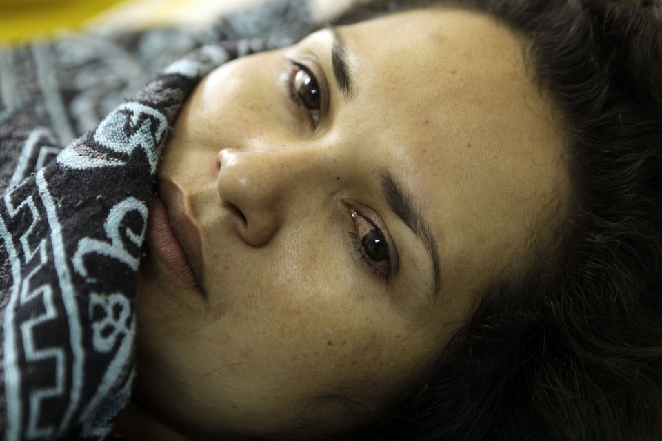 "In this Nov. 15, 2012 photo, Lucia Aguero lies in the hospital on the 50th day of her hunger strike in Coronel Oviedo, Paraguay. Aguero, a 25-year-old mother of two small children, was jailed after a chaotic pass through a hospital emergency room where doctors were too busy with the wounded to remove the bullet from her thigh. Aguero witnessed the ""Massacre of Curuguaty"" on June 15 when peace negotiations between farmers occupying a rich politician\'s land ended with a barrage of bullets that killed 11 farmers, including her brother, and 6 police officers. Aguero joined the hunger strike with others to protest being jailed without formal charges for the last six months. She lasted 59 days without food, and nearly died before a judge said she and three others could return home under police custody until the hearing. (AP Photo/Jorge Saenz)"