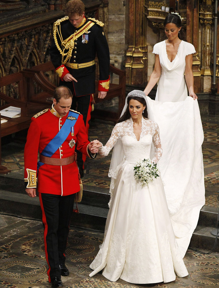 Photo - Britain's Prince William, foreground left, and his wife Kate, the Duchess of Cambridge, foreground right, best man Britain's Prince Harry, back left, and maid of honour Philippa Middleton, back right, accompany them following their wedding service at Westminster Abbey in London, Friday, April 29, 2011. (AP Photo/Kirsty Wigglesworth, Pool) ORG XMIT: LKW102