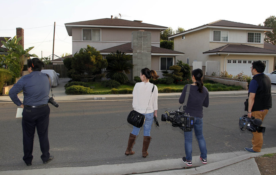 Photo - Japanese media wait outside the residence, left, of Dorian S. Nakamoto Thursday March 6, 2014, in Temple City, Calif. Nakamoto, the man that Newsweek claims is the founder of Bitcoin denies he had anything to do with it and says he had never even heard of the digital currency until his son told him he had been contacted by a reporter three weeks ago.   (AP Photo/Nick Ut)