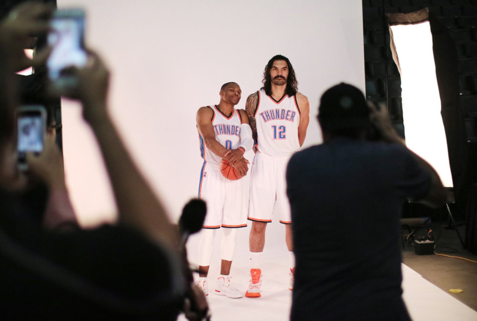 Photo - Russell Westbrook, left, and teammate Steven Adams during the Oklahoma City Thunder media day on Friday. (Photo by Doug Hoke, The Oklahoman)