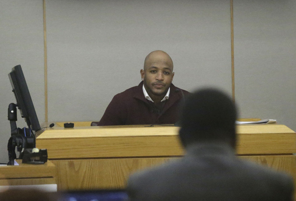 Photo - Dallas Cowboys safety Barry Church is questioned during the intoxication manslaughter trial of former Cowboys player Josh Brent, Thursday, Jan. 16, 2014, in Dallas. Brent is accused of driving drunk at the time of a Dec. 2012 crash that killed Cowboys practice squad player Jerry Brown. (AP Photo/LM Otero)