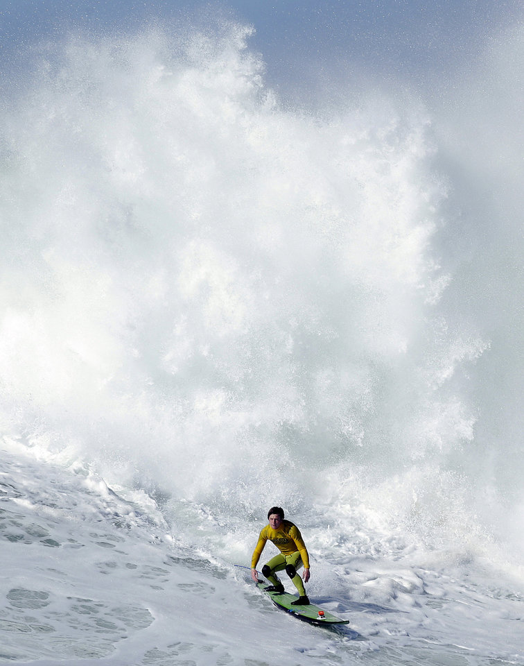 Colin Dwyer competes during heat 4 of the Mavericks Invitational big wave surf contest in Half Moon Bay, Calif., Sunday, Jan. 20, 2013. (AP Photo/Marcio Jose Sanchez)