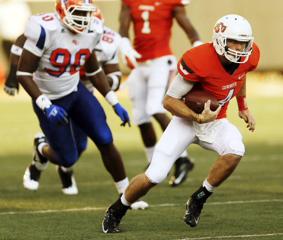 Photo - OSU quarterback J.W. Walsh (4) carries the ball during a college football game between Oklahoma State University (OSU) and Savannah State University at Boone Pickens Stadium in Stillwater, Okla., Saturday, Sept. 1, 2012. Photo by Nate Billings, The Oklahoman