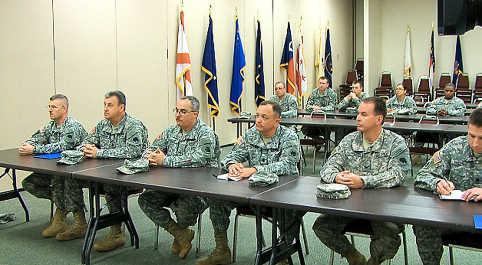 In this image from video, soldiers from the 45th Infantry Brigade Combat Team listen Tuesday as commanders announce that the unit will be deployed to Afghanistan next year.