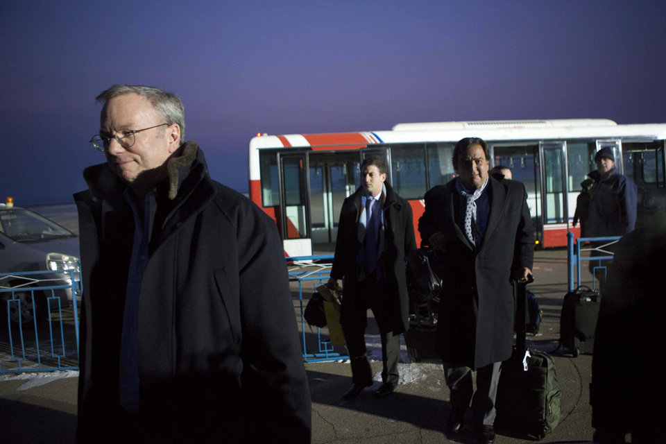 Photo - Executive Chairman of Google Eric Schmidt, left, disembarks from an airport transfer bus after arriving at Pyongyang International Airport in Pyongyang, North Korea on Monday, Jan. 7, 2013. Behind him, from left to right, are Google Ideas think tank director Jared Cohen and former New Mexico Gov. Bill Richardson. Richardson called the trip to North Korea a private humanitarian visit. (AP Photo/David Guttenfelder)