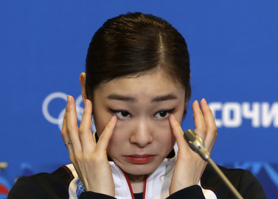 Photo - Yuna Kim of South Korea wipes her face as she attends a news conference following the women's free skate figure skating finals at the Iceberg Skating Palace during the 2014 Winter Olympics, Thursday, Feb. 20, 2014, in Sochi, Russia. (AP Photo/Darron Cummings)
