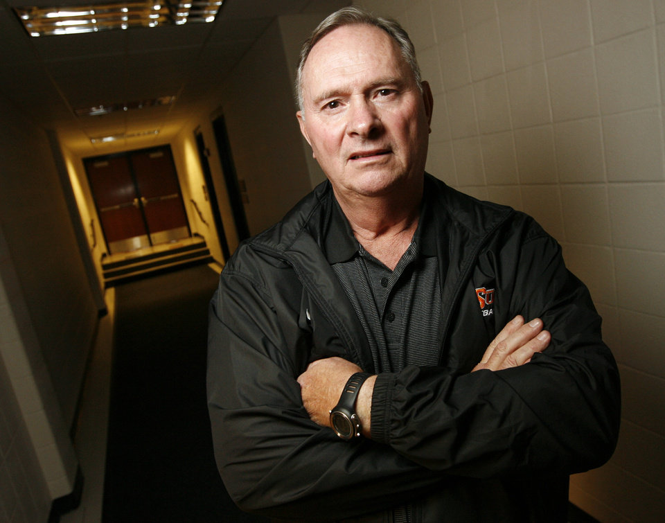 Photo - New OSU college football defensive coordinator Bill Young poses for a photo in a hall inside Gallagher-Iba Arena on the campus of Oklahoma State University in Stillwater, Okla., Friday, January 23, 2009. BY NATE BILLINGS, THE OKLAHOMAN ORG XMIT: KOD