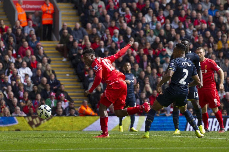 Photo - Liverpool's Daniel Sturridge, center, scores against Southampton during their English Premier League soccer match at Anfield Stadium, Liverpool, England, Sunday Aug. 17, 2014. (AP Photo/Jon Super)
