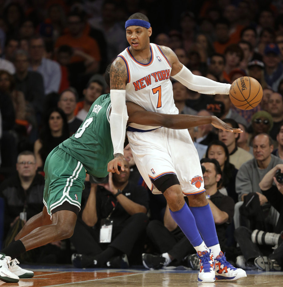 Photo - New York Knicks forward Carmelo Anthony (7) leans on defending Boston Celtics forward Jeff Green (8) as he controls the ball in the second half of Game 1 of a first-round NBA basketball playoff series, in New York on Saturday, April 20, 2013. The Knicks won 85-78. (AP Photo/Kathy Willens)