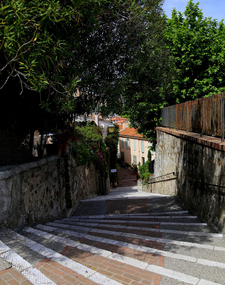 Photo - This picture, taken May 11, 2014, shows a winding stair case leading up to Le Suquet, a hillside in Cannes' Old Town where visitors can wander and enjoy sweeping views of the resort. Cannes is a favorite destination for the wealthy _ and for celebrities who walk the red carpet at the Cannes Film Festival each May _ but the Riviera resort also offers plenty of simple, inexpensive pleasures, from the beach to street strolls. (AP Photo/Michelle Locke)