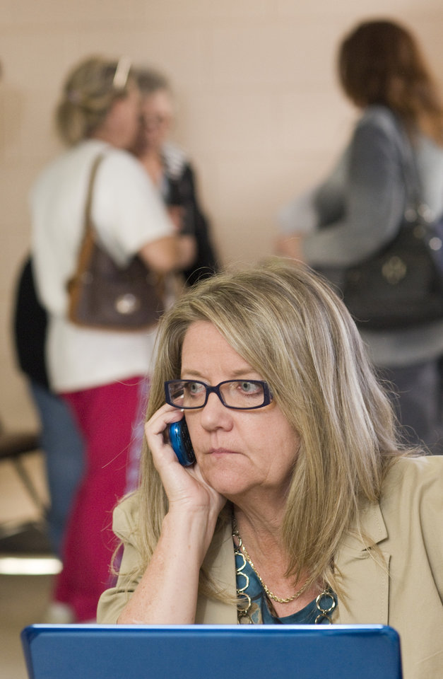 Bonnie J. Hackbarth, a senior public relations counselor hired by Paducah & Louisville Railroad, fields calls from a help line for residents of West Point, Ky., as they remain evacuated from their homes Thursday, Nov. 1, 2012 at the Paducah & Louisville Outreach Center located at VFW Post 1181 in southwest Louisville, Ky. A Paducah & Louisville Railway train carrying hazardous chemicals derailed just after 6 a.m. EDT Monday. A leak of a potentially explosive material was contained, but authorities say three workers were severely burned in a fire that erupted while contractors were removing debris from the train Thursday in southwest Louisville. (AP Photo/Brian Bohannon)