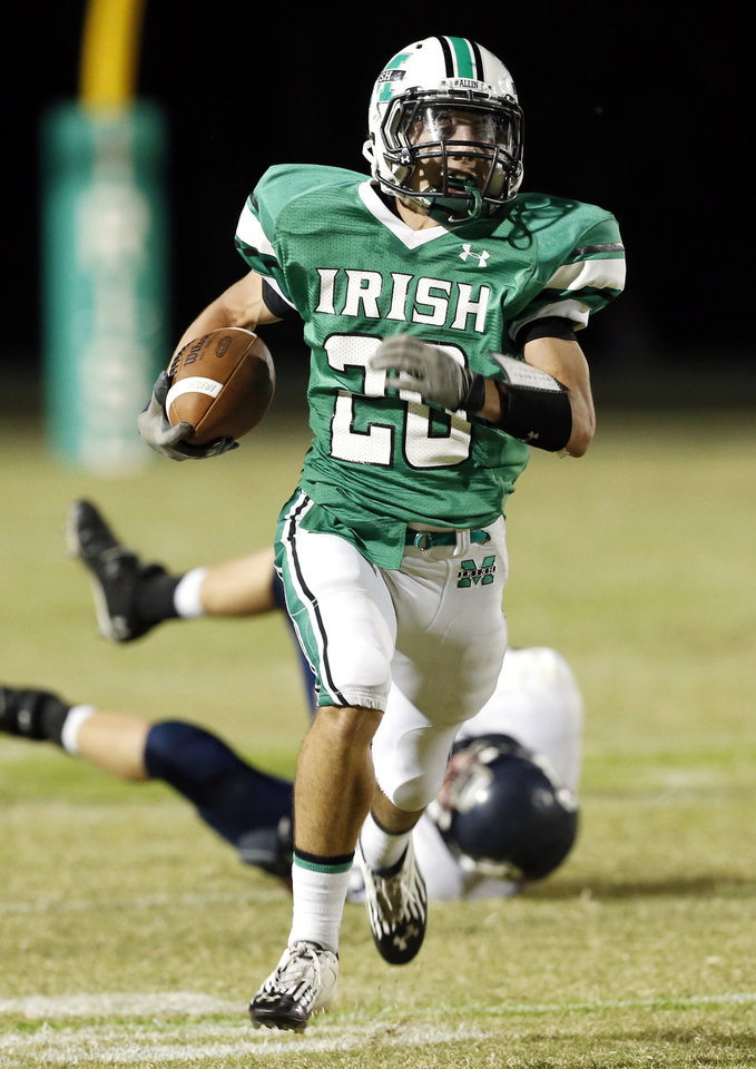 Photo - McGuinness' Braden Roy (20) takes off on a touchdown run as the El Reno Indians play the Bishop McGuinness Fighting Irish in high school football on Friday, Sept. 21, 2012 in Oklahoma City, Okla.  Photo by Steve Sisney, The Oklahoman