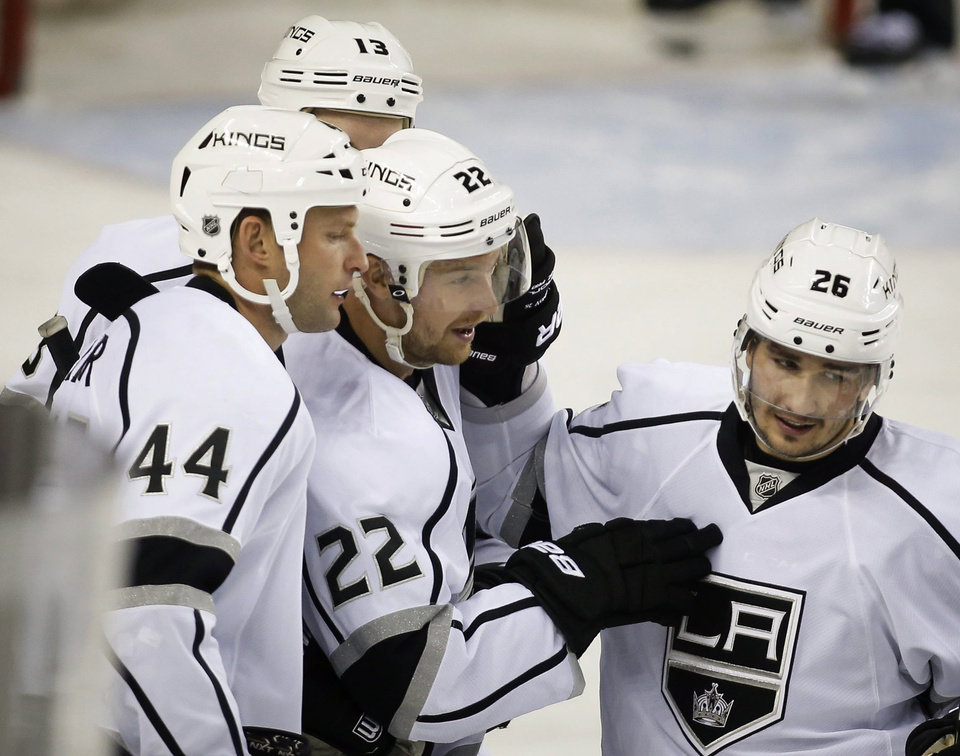 Photo - Los Angeles Kings' Trevor Lewis, center, celebrates his goal with teammates during the first period of an NHL hockey game against the Calgary Flames in Calgary, Alberta, Monday, March 10, 2014. (AP Photo/The Canadian Press, Jeff McIntosh)