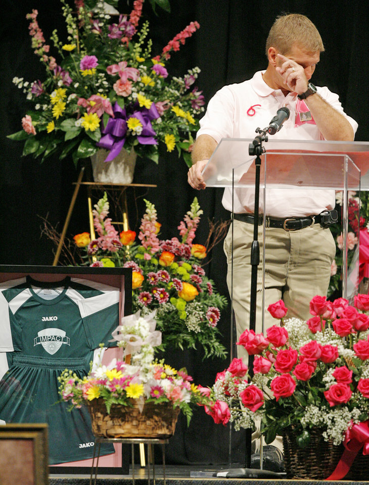 Photo - DEATH: Peter Koskovich, Haley Palmer's soccer coach, wipes his face as he speaks about Palmer during her memorial service at First Baptist Church in Owasso, Okla., on Thursday, June 19, 2008. At lower left is Palmer's soccer jersey which Koskovich presented to Palmer's family. Palmer died from complications from cystic fibrosis on Friday, June 13, 2008, in St. Louis while waiting for a double-lung transplant. BY NATE BILLINGS, THE OKLAHOMAN ORG XMIT: KOD
