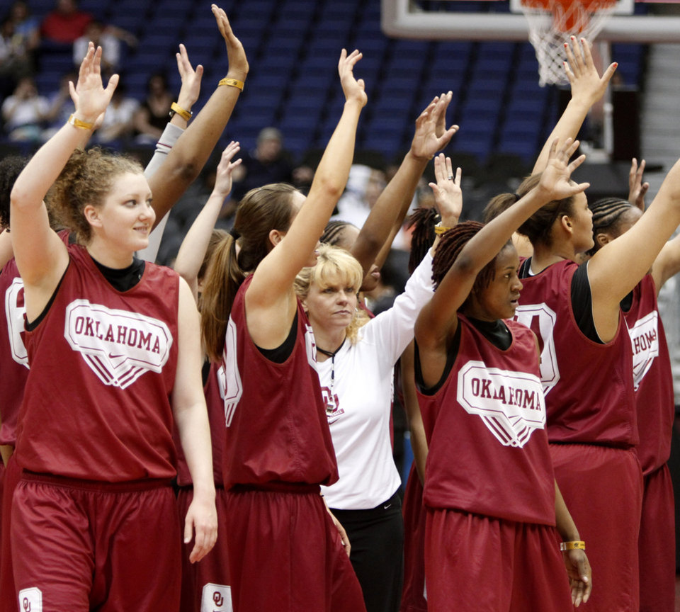 OU coach Sherri Coale and her team wave to the crowd after practice for the Final Four of the NCAA women's  basketball tournament at the Alamodome in San Antonio, Texas., on Saturday, April 3, 2010.  The University of Oklahoma will play Stanford on Sunday, April 4, 2010.