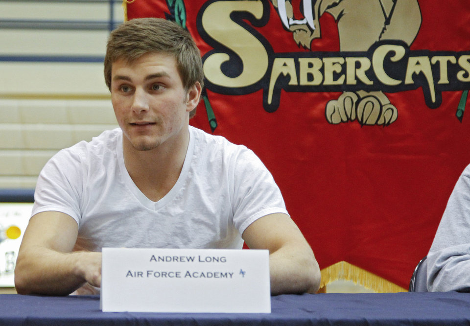 Photo - Southmoore High School's Andrew Long sits at a table after signing his letter of intent to play football at the Air Force Academy during National Signing Day at Southmoore High School on Wednesday, Feb. 1, 2012, in Oklahoma City, Okla. Photo by Chris Landsberger, The Oklahoman