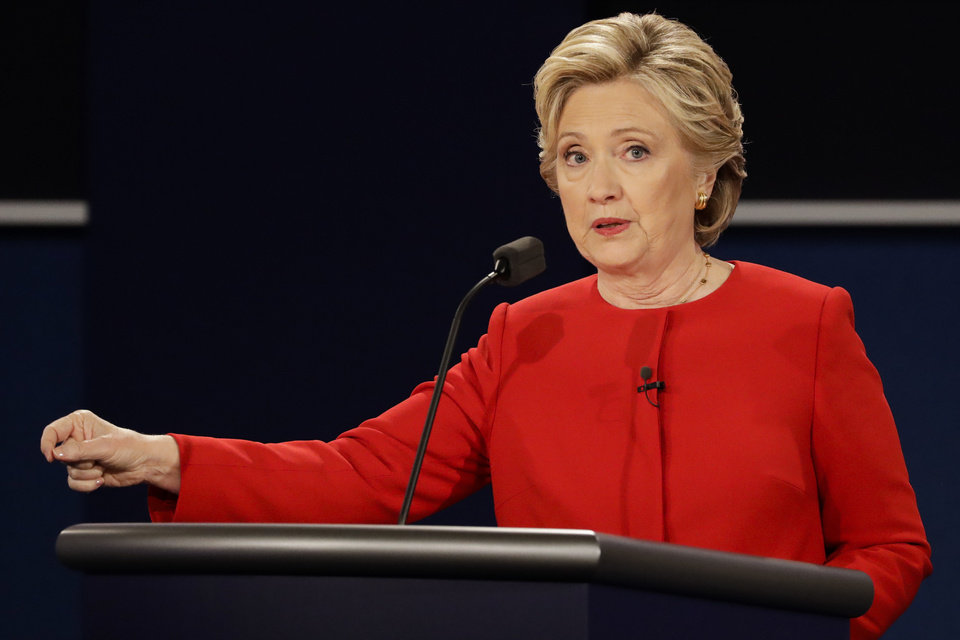 Photo - Democratic presidential nominee Hillary Clinton answers a question during the presidential debate with Republican presidential nominee Donald Trump at Hofstra University in Hempstead, N.Y., Monday, Sept. 26, 2016. (AP Photo/David Goldman)