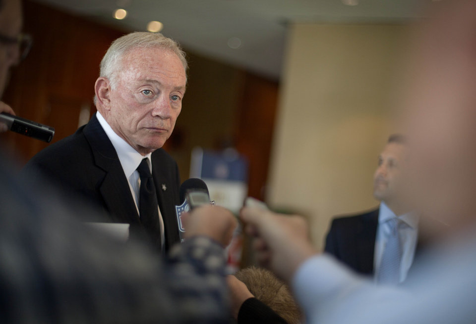 Photo -   Dallas Cowboys owner Jerry Jones speaks to the media as he leaves an NFL owners meeting Tuesday, May 22, 2012, in Atlanta. (AP Photo/David Goldman)