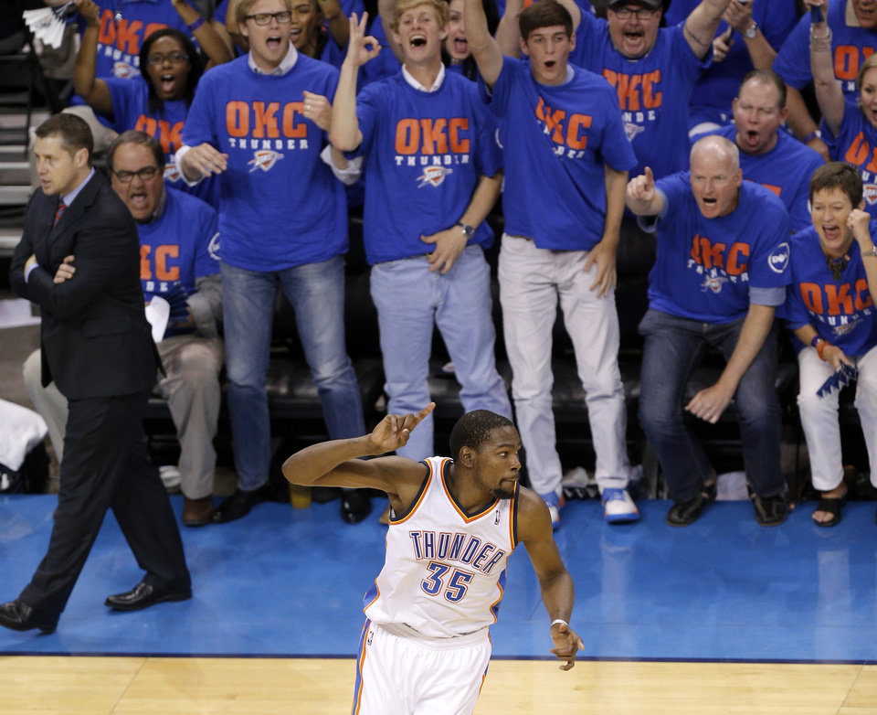Photo - Fans celebrate a basket by Oklahoma City's Kevin Durant (35) during Game 7 in the first round of the NBA playoffs between the Oklahoma City Thunder and the Memphis Grizzlies at Chesapeake Energy Arena in Oklahoma City, Saturday, May 3, 2014. Photo by Sarah Phipps, The Oklahoman