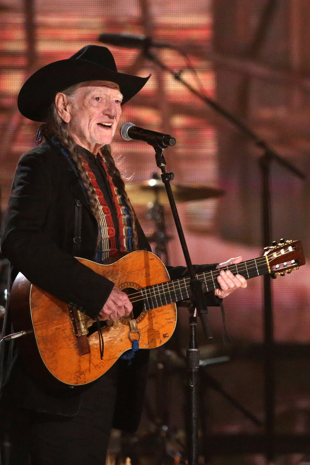 Photo - Willie Nelson performs on stage at the 56th annual Grammy Awards at Staples Center on Sunday, Jan. 26, 2014, in Los Angeles. (Photo by Matt Sayles/Invision/AP)