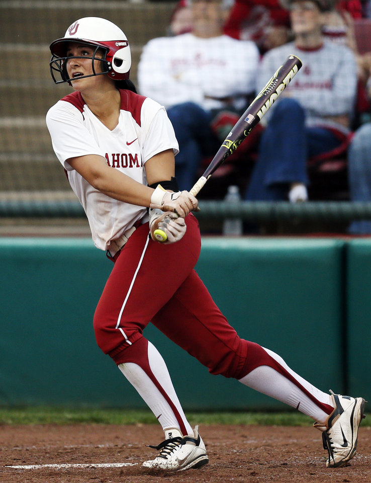 OU's Lauren Chamberlain (44) hits a 3-run home run in the 1st inning during an NCAA softball game between OU and Marist in the Oklahoma Regional in Norman, Okla., Friday, May 17, 2013. Oklahoma won 17-0 in 5 innings. Photo by Nate Billings, The Oklahoman