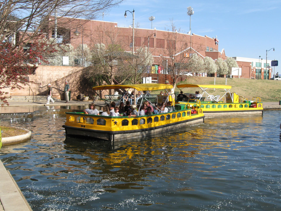 Photo - Bricktown water taxis were kept full with passengers this week as area attractions reported higher-than-normal business, likely because of the down economy.  PHOTO PROVIDED BY BRICKTOWN WATER TAXI   ORG XMIT: 0903182226587410