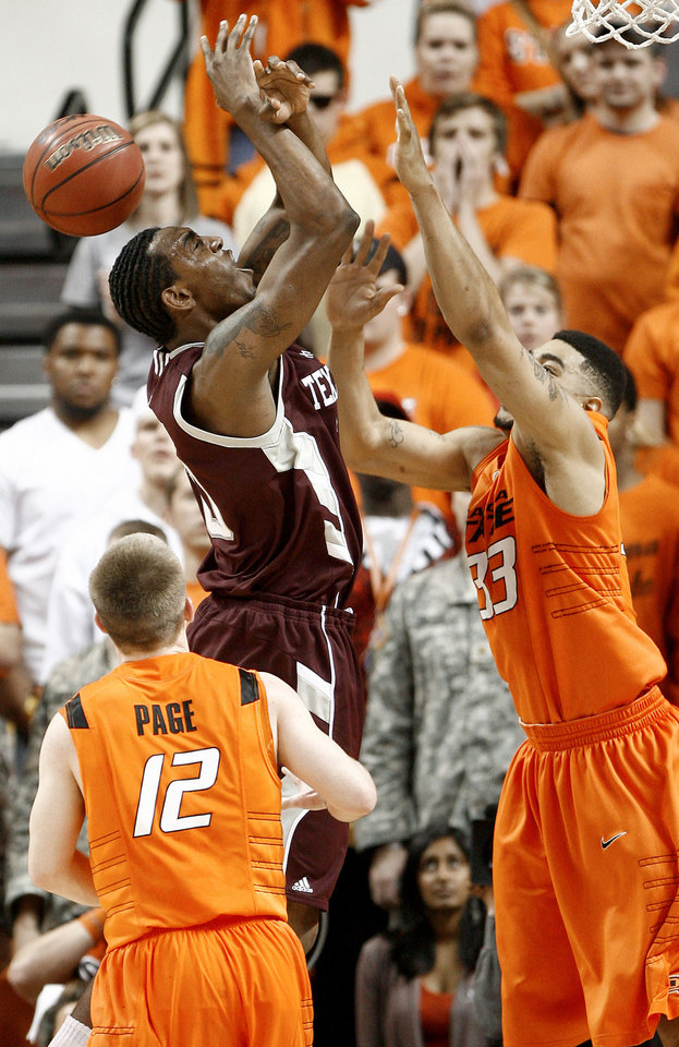 Photo - OSU's Marshall Moses, right, blocks the shot of Texas A&M's David Loubeau as Keiton Page watches during an NCAA college basketball game between the Oklahoma State University and Texas A&M at Gallagher-Iba Arena in Stillwater, Okla., Wednesday, January 27, 2010. Photo by Bryan Terry, The Oklahoman