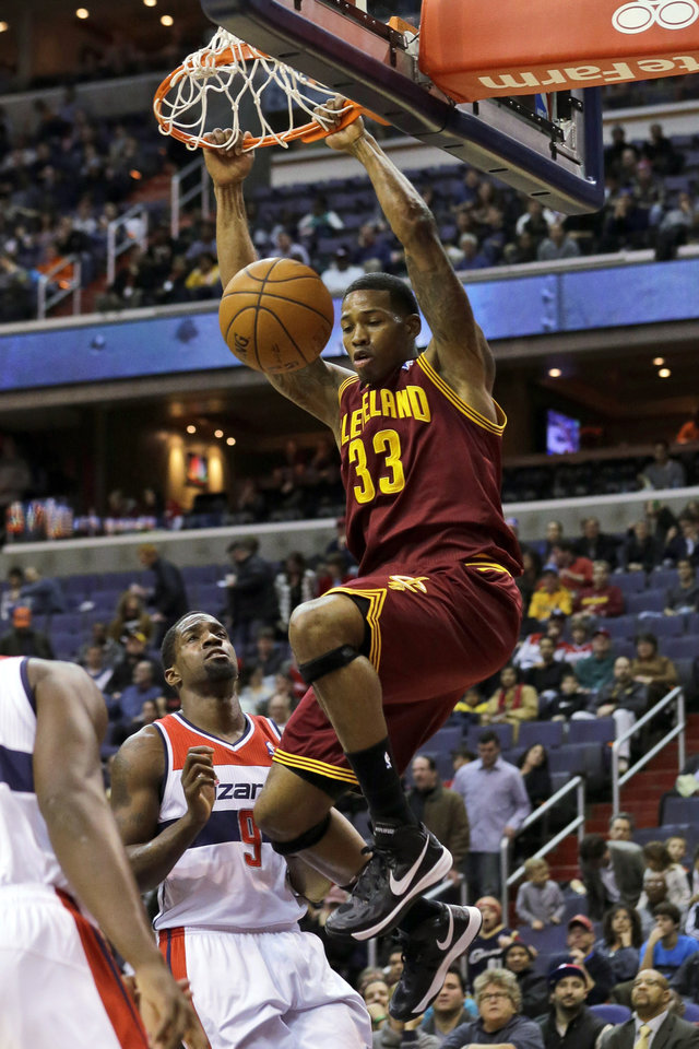 Photo - Cleveland Cavaliers forward Alonzo Gee dunks in front of Washington Wizards forward Martell Webster in the first half of an NBA basketball game, Wednesday, Dec. 26, 2012, in Washington. (AP Photo/Alex Brandon)