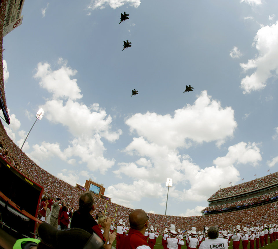 Fans watch as jets fly over the stadium before the first half of the college football gamebetween the University of Oklahoma Sooners (OU) and Air Force (AF) at the Gaylord Family-Oklahoma Memorial Stadium on Saturday, Sept. 18, 2010, in Norman, Okla.   Photo by Bryan Terry, The Oklahoman
