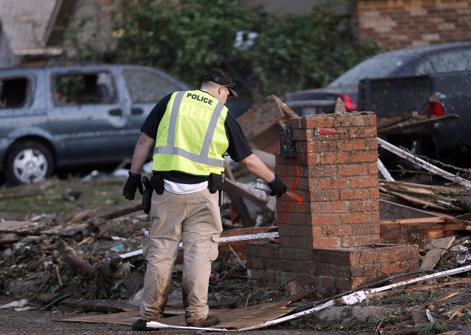 An official marks a searched home in a residential area near the off Telephone Road in Moore following a deadly tornado, Monday, May 20, 2013. Photo by Sarah Phipps, The Oklahoman