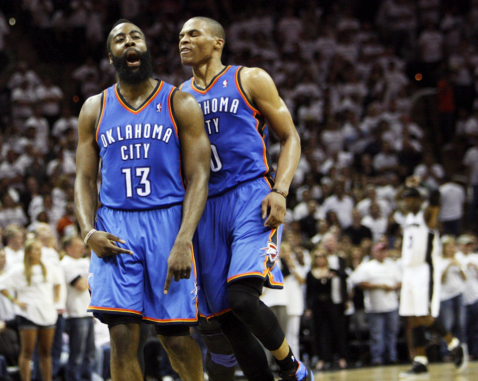 Photo - James Harden (13) celebrates with Russell Westbrook (0) after making a 3-point shot late in the fourth quarter during Game 5 of the Western Conference Finals between the Oklahoma City Thunder and the San Antonio Spurs in the NBA basketball playoffs at the AT&T Center in San Antonio, Monday, June 4, 2012. The Thunder won, 108-103. Photo by Nate Billings, The Oklahoman