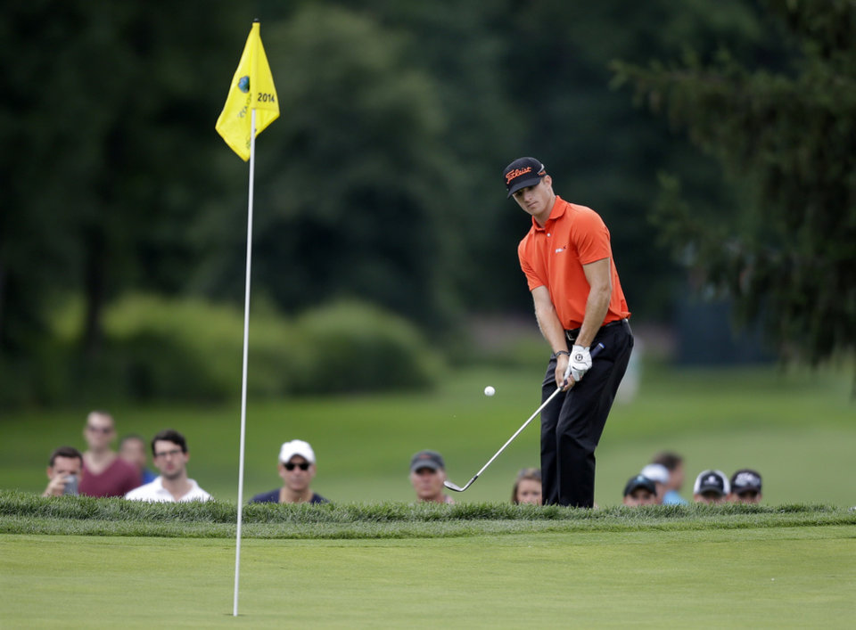 Photo - Morgan Hoffman, of Wyckoff, N.J., hits a shot onto the green on the third hole during the final round of play at The Barclays golf tournament Sunday, Aug. 24, 2014, in Paramus, N.J. (AP Photo/Mel Evans)