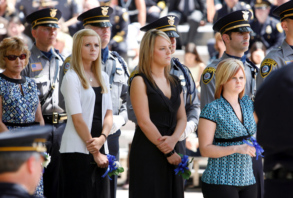 Photo - Volunteers wait in line to lay flowers on a memorial to fallen officers as they are remembered at a service in front of Oklahoma City Police Headquarters in Oklahoma City, Oklahoma on Friday, May 9, 2008.   BY STEVE SISNEY, THE OKLAHOMAN