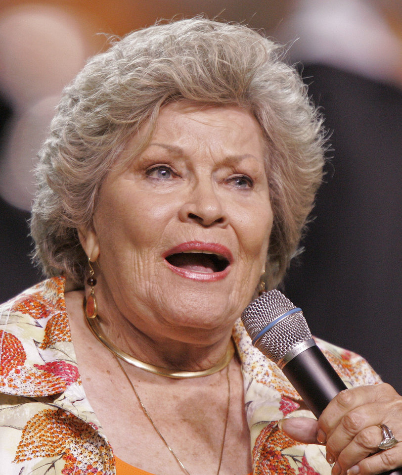 "In this Sept. 26, 2009 file photo, singer Patti Page performs the Tennessee Waltz during halftime of a NCAA college football game Tennessee and Ohio in Knoxville, Tenn. Page, who made ""Tennessee Waltz"" the third best-selling recording ever, has died. She was 85. AP Photo <strong>Wade Payne</strong>"