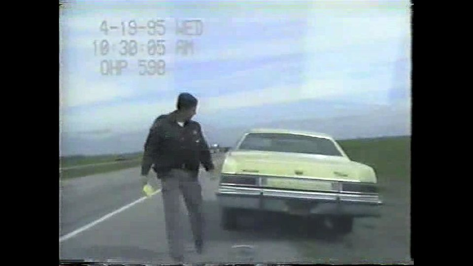 Photo - Video stills from a dashboard camera show Trooper Charlie Hanger moments after he arrested Oklahoma City bomber Timothy McVeigh. McVeigh was stopped 75 minutes after the bombing because his car had no tag and was arrested on a firearm complaint when Hangar disovered he was carrying a loaded Glock pistol.  PROVIDED
