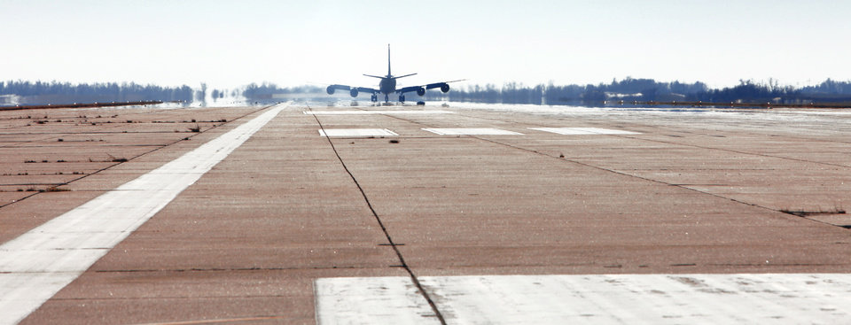 Photo - A military plane practices a touch-and-go landing on the runway.  photo by DAVID MCDANIEL, THE OKLAHOMAN