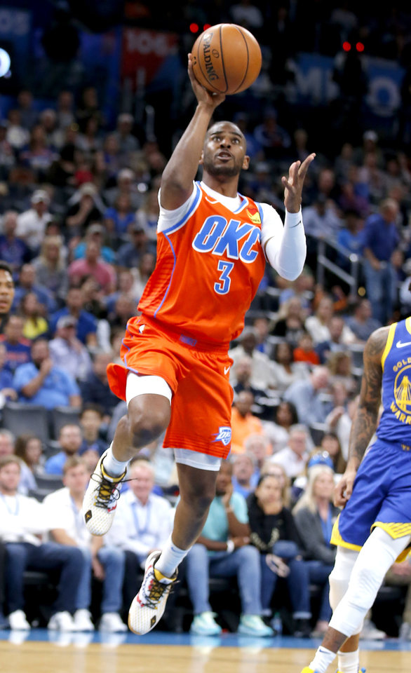 Photo - Oklahoma City's Chris Paul (3) goes up for a lay up during the NBA game between the Oklahoma City Thunder and Golden State Warriors at Chesapeake Energy Arena,  Sunday, Oct. 27, 2019. Thunder won 120-92.[Sarah Phipps/The Oklahoman]