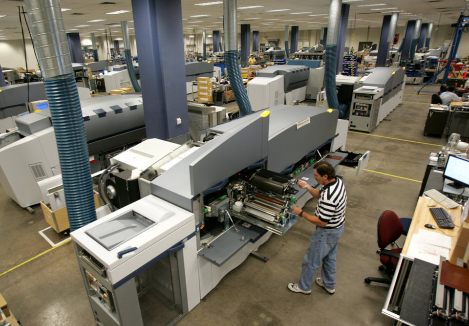 FILE - In this Aug. 1, 2006, file photo, Eastman Kodak Co. employee Doug Kanous assembles a Kodak NexPress digital production printer at the graphic communications plant in Rochester, N.Y. Kodak announced on Wednesday, Dec. 19, 2012, that it has found a buyer for its imaging patent portfolios, an important step for the company as it tries to emerge from bankruptcy protection in the first half of 2013. (AP Photo/David Duprey, file)
