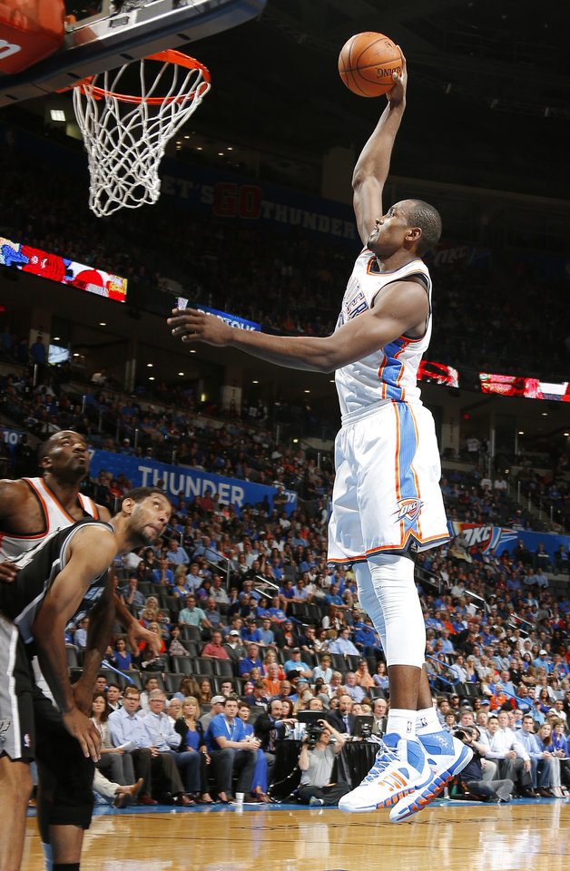 Photo - Oklahoma City's Serge Ibaka (9) goes to the basket during an NBA basketball game between the Oklahoma City Thunder and the San Antonio Spurs at Chesapeake Energy Arena in Oklahoma City, Thursday, April 3, 2014. Oklahoma City won 106-94. Photo by Bryan Terry, The Oklahoman