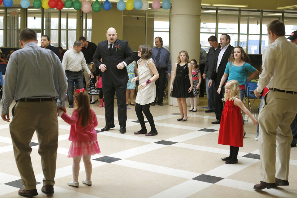 Fathers and daughters dance during the Deer Creek Daddy daughter dance at Deer Creek High School in Oklahoma City, OK, Saturday, January 26, 2013,  By Paul Hellstern, The Oklahoman