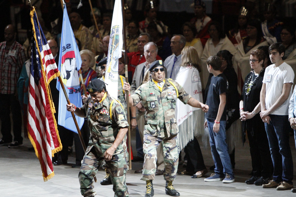 Military veterans leading the Grand Entry of Dancers at the Red Earth Festival in Oklahoma City on Friday, June 7, 2013. Photo by Aliki Dyer, The Oklahoman