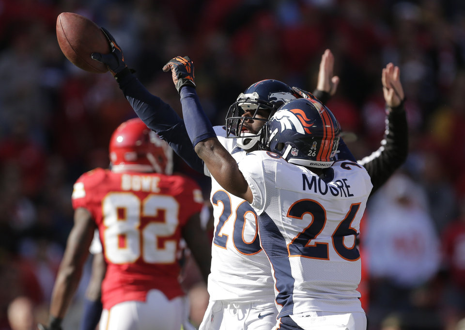 Photo -   Denver Broncos strong safety Mike Adams (20) celebrates a fumble recovery with free safety Rahim Moore (26) during the first half of an NFL football game against the Kansas City Chiefs at Arrowhead Stadium in Kansas City, Mo., Sunday, Nov. 25, 2012. (AP Photo/Charlie Riedel)