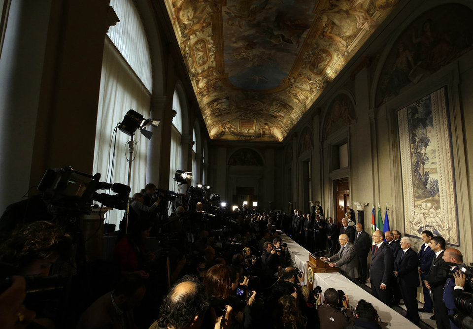 Italian designate-Premier Enrico Letta and Italian President Giorgio Napolitano meet journalists the Quirinale, presidential palace, in Rome, Saturday, April 27, 2013. Italy has finally has a new government, a coalition of Berlusconi's forces and center-left rivals who forged an unusual alliance to break a two-month stalemate following inconclusive elections. Enrico Letta, a center-left leader, will be premier in the government, which marks the latest political comeback by Silvio Berlusconi. (AP Photo/Gregorio Borgia)