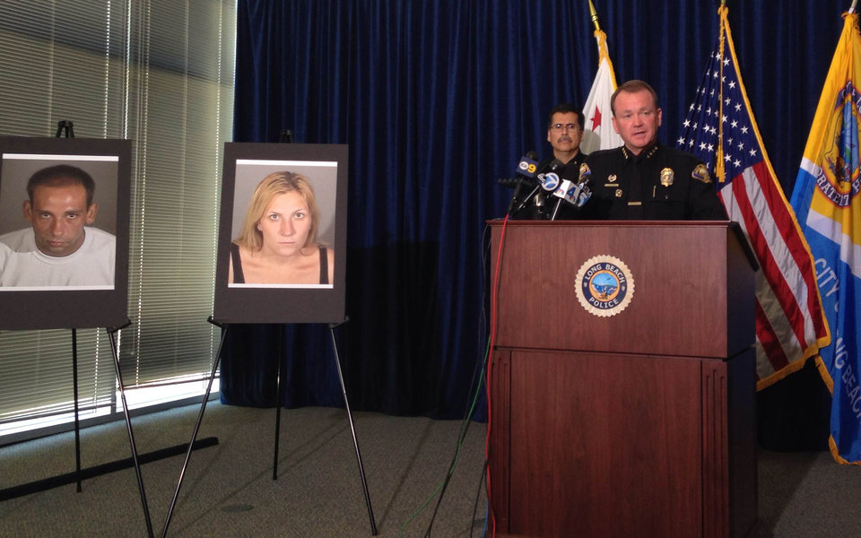 Photo - Long Beach Police Chief Jim McDonnell leads a news conference Thursday, July 24, 2014, in Long Beach, Calif. Police said they're deciding whether to arrest an 80-year-old man who shot a fleeing, unarmed burglar despite her telling him she was pregnant, but they have arrested the woman's accomplice on suspicion of murder for taking part in a crime that led to her death. Photos at left show the surviving suspect, Gus Adams, and the Andrea Miller, who was killed. (AP Photo/The Press-Telegram, Gregory Yee)