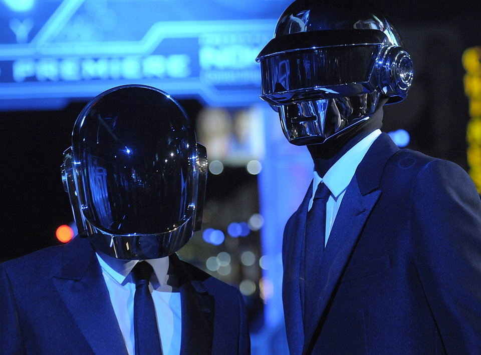 "FILE - In this Dec. 11, 2010 file photo, musician Guy-Manuel de Homem-Christo, left, and musician Thomas Bangalter of the duo Daft Punk arrive at the premiere of the feature film ""Tron: Legacy"" in Los Angeles.  Daft Punk's ""Get Lucky_Radio Edit"" was the most viral track on Spotify, based on the number of people who shared it divided by the number who listened to it, from Monday, April 2, to Sunday, April 28, via Facebook, Tumblr, Twitter and Spotify. It was also the most streamed tracks on Spotify. (AP Photo/Dan Steinberg)"