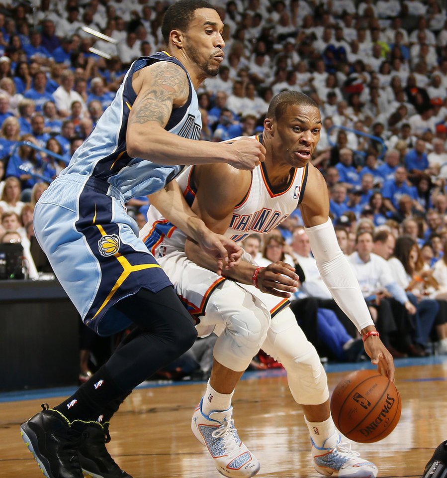 Photo - Oklahoma City's Russell Westbrook (0) goes around Memphis' Courtney Lee (5) during Game 2 in the first round of the NBA playoffs between the Oklahoma City Thunder and the Memphis Grizzlies at Chesapeake Energy Arena in Oklahoma City, Monday, April 21, 2014. Photo by Nate Billings, The Oklahoman